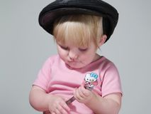 Cute child and instrument Royalty Free Stock Image