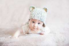 Cute child in knitted bear hat stock photography