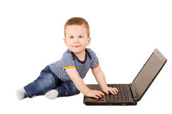 Cute child with laptop. Cute one year old child with laptop isolated on white background Stock Images