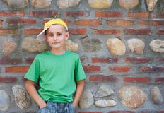 Cute child leaning on a wall Stock Images