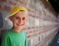 Cute child leaning on a wall Stock Image