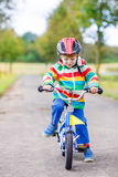 Cute child learning to ride a bike Royalty Free Stock Image