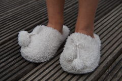 Cute child legs in slippers Stock Image