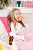 Cute child licking lemon Stock Photos