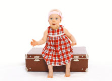 Cute child little girl in dress sitting on the suitcase playing Royalty Free Stock Photography