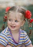 Cute child with long hair. Stock Photos