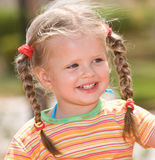 Cute child with long hair. Nature. Stock Images