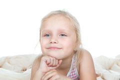 Cute child lying in bed Stock Images