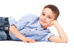Cute Child Lying on Floor Stock Image