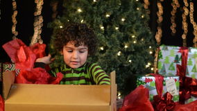 Cute Child Opens Christmas Present stock video