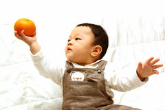 Cute Child with orange Stock Photos