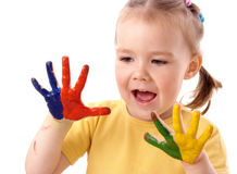 Cute child with painted hands. Cute cheerful child with painted hands, isolated over white Royalty Free Stock Images