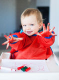 Cute child with painted hands Royalty Free Stock Images