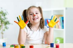 Cute child painting her hands Stock Photo