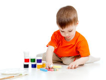 Cute child with paints and chalks Royalty Free Stock Images