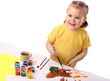 Cute child play with paints Royalty Free Stock Photos