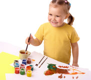 Cute child play with paints Royalty Free Stock Image
