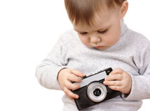 Cute child play with photocamera Royalty Free Stock Photography
