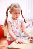 Cute child playing royalty free stock photos