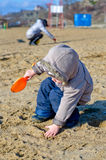 Cute child playing on the beach Royalty Free Stock Photography