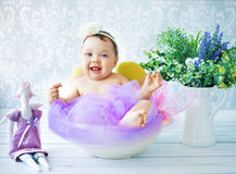 Cute child playing in the colorful room Stock Images