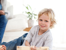 Cute child playing with dominoes Stock Photo