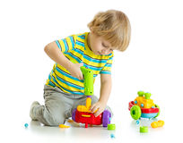 Cute child playing with educational isolated on white background. Royalty Free Stock Photography