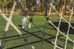 Cute child playing football with joy Royalty Free Stock Image