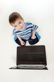 Cute child playing with laptop. Top view. Royalty Free Stock Photos