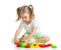 Cute child playing with mosaic toy Stock Photo