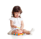 Cute child playing with musical toy Stock Images