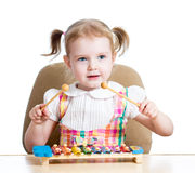 Cute child playing musical toy Stock Images
