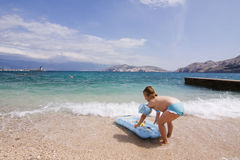 Cute child playing in the ocean Stock Photography