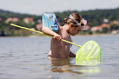 Cute child playing in the ocean Royalty Free Stock Images