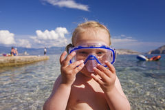 Cute child playing in the ocean Stock Image
