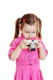 Cute child playing with photocamera Royalty Free Stock Images