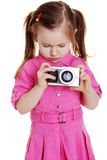 Cute child playing with photocamera Royalty Free Stock Image