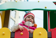 Cute baby playing. Cute child playing at the playground stock photography