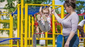 Cute Child Playing In Playground Royalty Free Stock Images