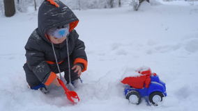 Cute child playing with snow stock video