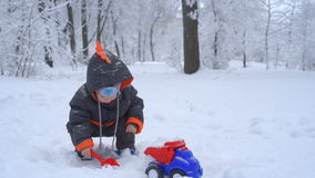 Cute child playing with snow stock footage