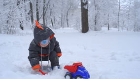 Cute child playing with snow stock video footage