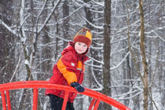 Cute child playing in a snowy park Stock Images