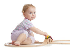 Cute child is playing with wooden train Stock Images
