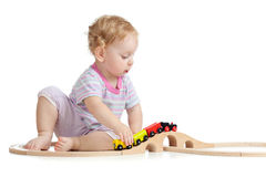 Cute child is playing with wooden train Stock Photos