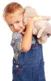 Cute child with plush toy. In hands royalty free stock image