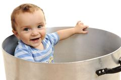 Cute child in pot. Playing royalty free stock photography