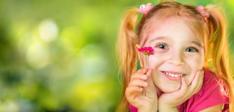 Cute Child With Purple Daisy stock photo
