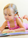 Cute child reading royalty free stock image