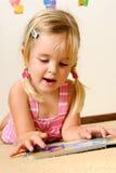Cute child reading Stock Photos